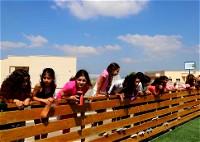 مجلس كفرقرع يسلم ملعب العشب الصناعي لجسر على الوادي