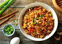 أرز بالدجاج والخضار.. صحتين وهنا